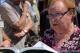 """<p>Magda Rover, esule da Antignana residente a Vasto,<br />legge la sua toccante poesia dedicata a Norma Cossetto</p> <p>Io ero là, Norma!<br /> Radiosa di fresca, ardente giovinezza,/ correvi la Vita, in bici,/<br />lungo le strade, i sentieri ella tua Terra./ Preparavi la tesi di laurea:/<br /> """"Istria Rossa"""", ossa di bauxite./ E cercavi… cosa, come, dove?/<br /> Non lo sapremo ai!/ Venuta alla luce, poco dopo la restituzione delle<br />Terre/ Istro-giuliano-dalmate alla Madre Patria,/ avresti raccontato<br />del """"rosso"""" che allora/ le aveva irrorate? Forse no:/<br />quel dato era ormai acclarato!/ Tu volevi scoprire altro... Era<br />così?/ Non lo sapremo mai!/ Mentre andavi,/ ti accarezzavano<br />brezze leggere, refoli di bora,/ gioivi dei silenzi, voci, fruscii,<br />sussurri.../ ti avvolgevano i forti gradevoli odori/ delle<br />zolle testé dissodate, dei prati, le brughiere, i boschi./ Sì, i<br />boschi!/ Non sospettavi, disarmata agnella,/ che il mostro<br />genocida,/ schiavo dell'ideologia perversa di Kardelj e Tito,/ ti<br />guatasse dal folto e trappole per te allestisse./ Ti razziarono<br />alfine. Tentarono corromperti:/ volevano tu rinnegassi Fede e<br />Patria,/ ti aggregassi a lor progetto di sterminio./ Al tuo fermo<br />rifiuto, esplose lor bieco furore./ Risuonarono nel cuore angosciato,/<br />della madre, ancor ignara di tua sorte,/ le invocazioni,<br />i gemiti, i lamenti?/ Non lo sapremo mai./ Dopo, ignominioso,<br />prolungato strazio,/ ti accolse: seviziata, impalata, riversa/<br />sul cumulo dei tuoi compagni di sventura,/ la foiba di Surani./<br />E, quando la voragine rivelò il misfatto,/ io ero là, Norma, di<br />fronte a te, all'orrore,/ e all'impietrito sgomento dei parenti dei<br />""""desaparecidos""""./ Io ero là, avevo sette anni, e… cercai una<br />foiba anche per me!</p>"""